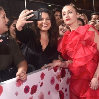 """Miley Cyrus Premiere Of Warner Bros. Pictures' """"Isn't It Romantic"""" - Red Carpet"""