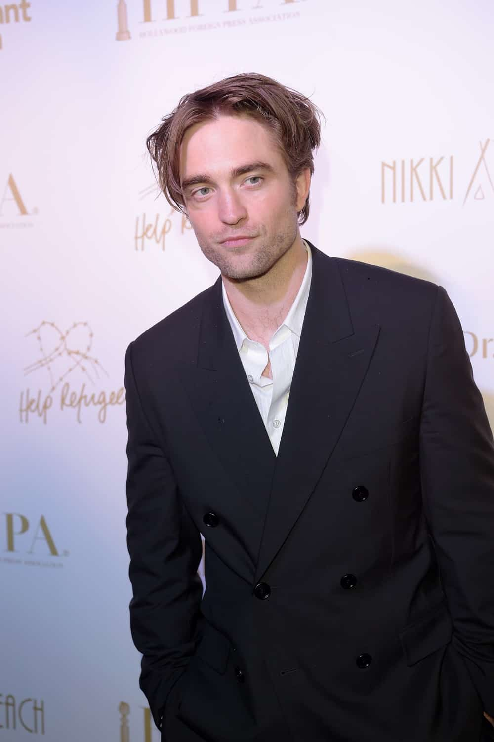 Robert Pattinson HFPA & Participant Media Honour Help Refugees' Arrivals - The 72nd Annual Cannes Film Festival