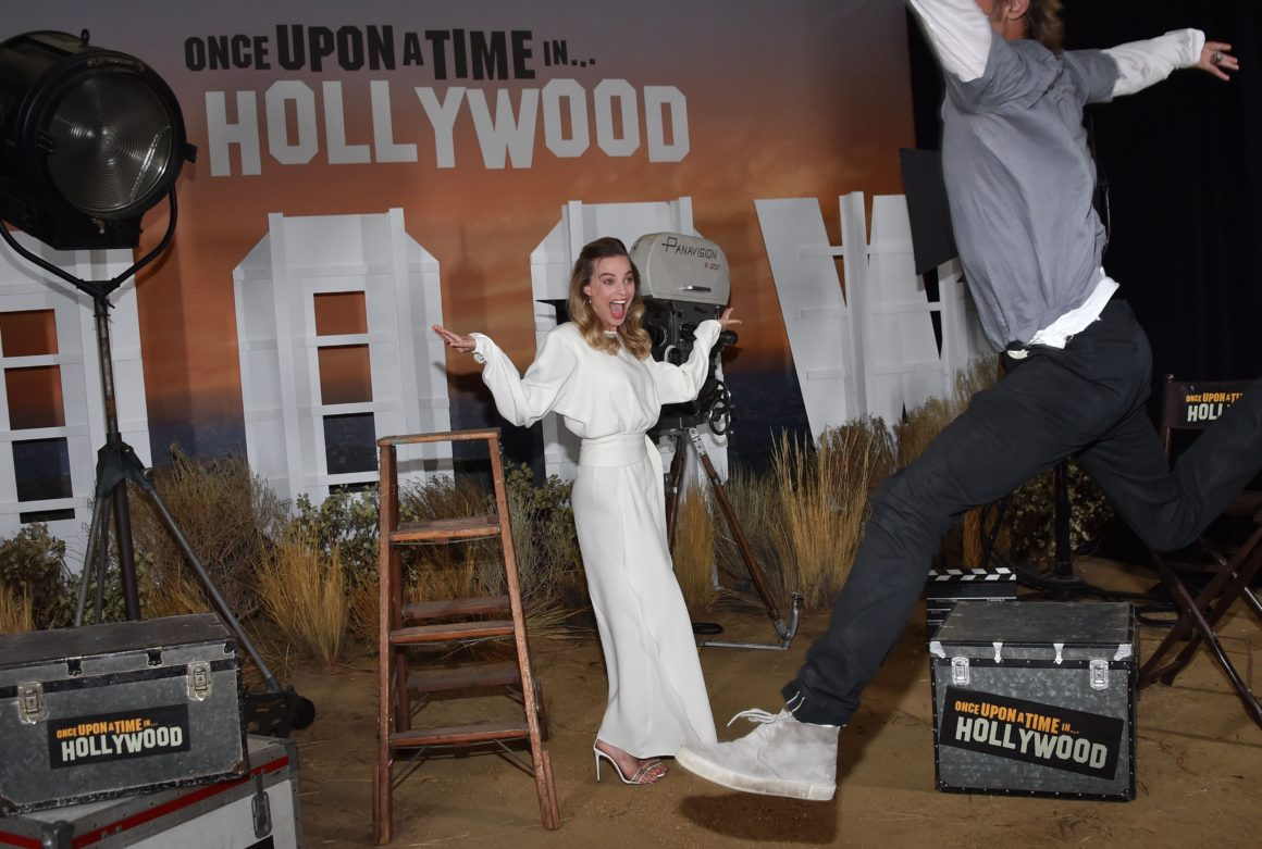 Brad Pitt Photobombs Margot Robbie