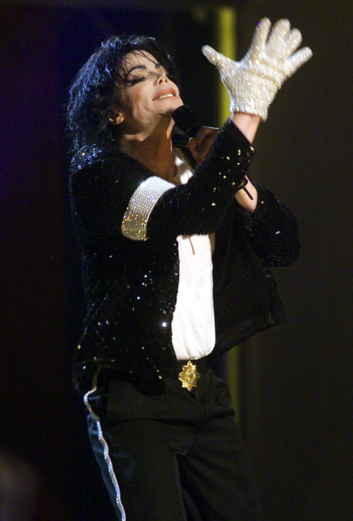 Michael Jackson sports a white glove during his fi
