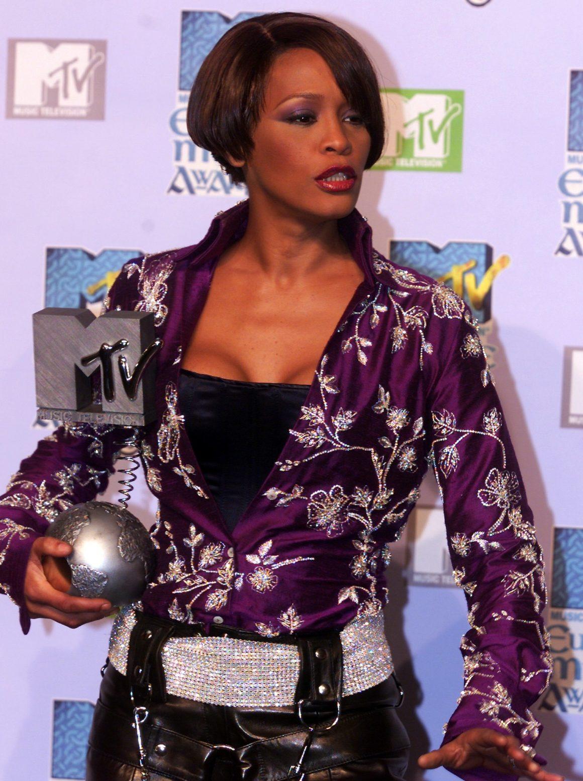 US singer Whitney Houston holds her awa