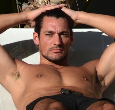 David Gandy relaxes by the pool in South Beach