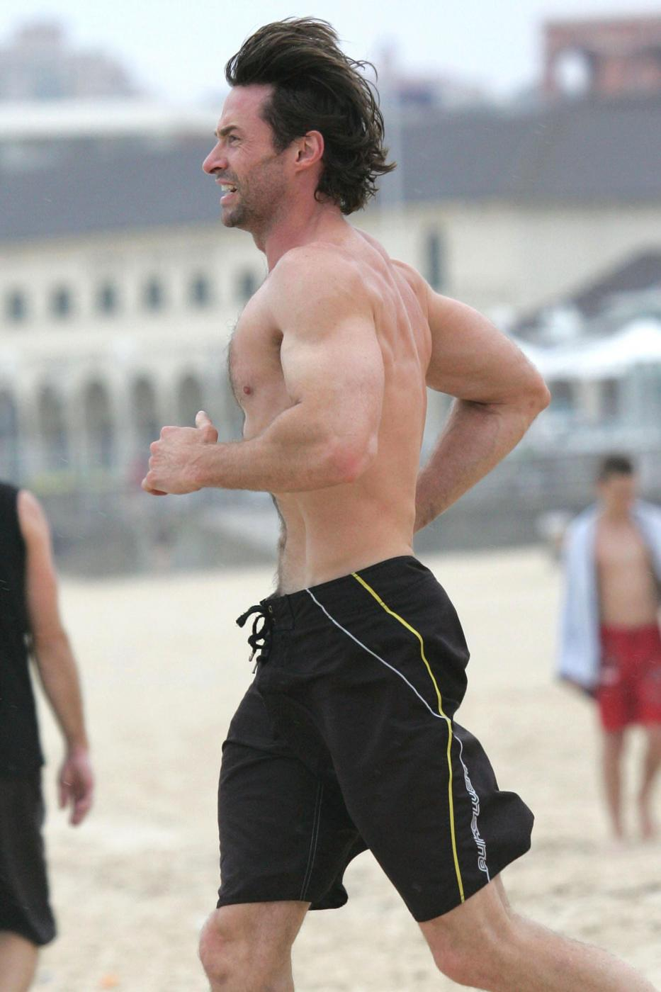 Hugh Jackman shows off his muscles during an early morning dip at Bondi Beach
