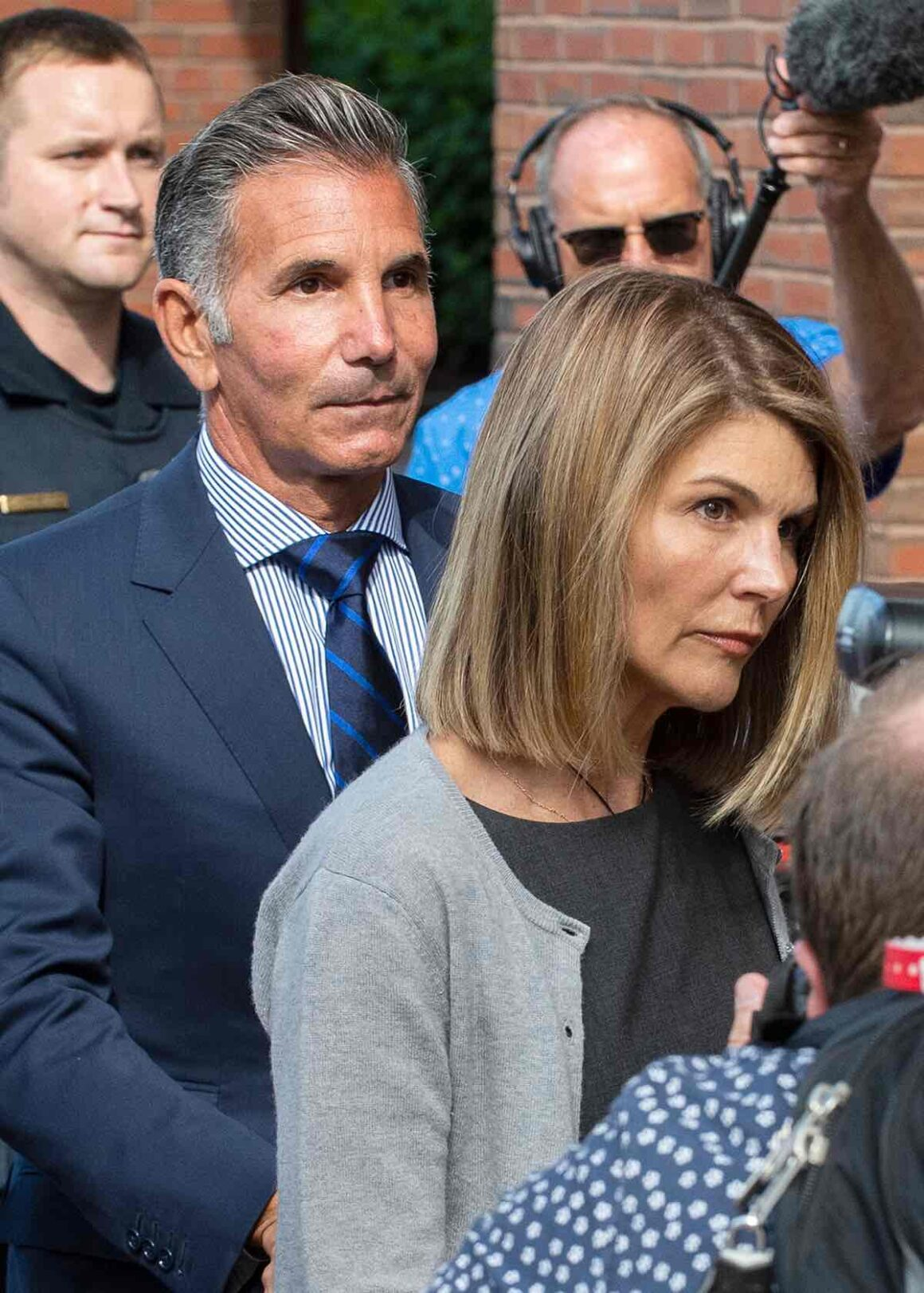 Actress Lori Loughlin and husband Mossimo Giannulli exit the Boston Federal Court house