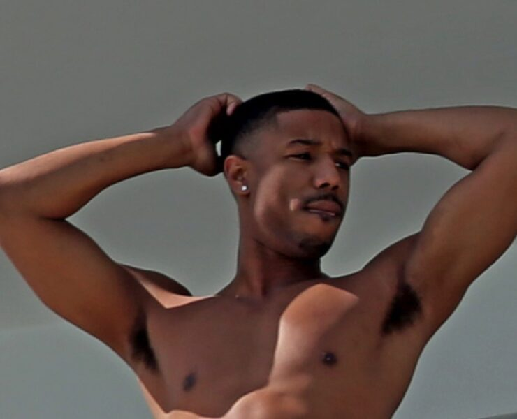 Michael B. Jordan shirtless on his hotel balcony in Miami