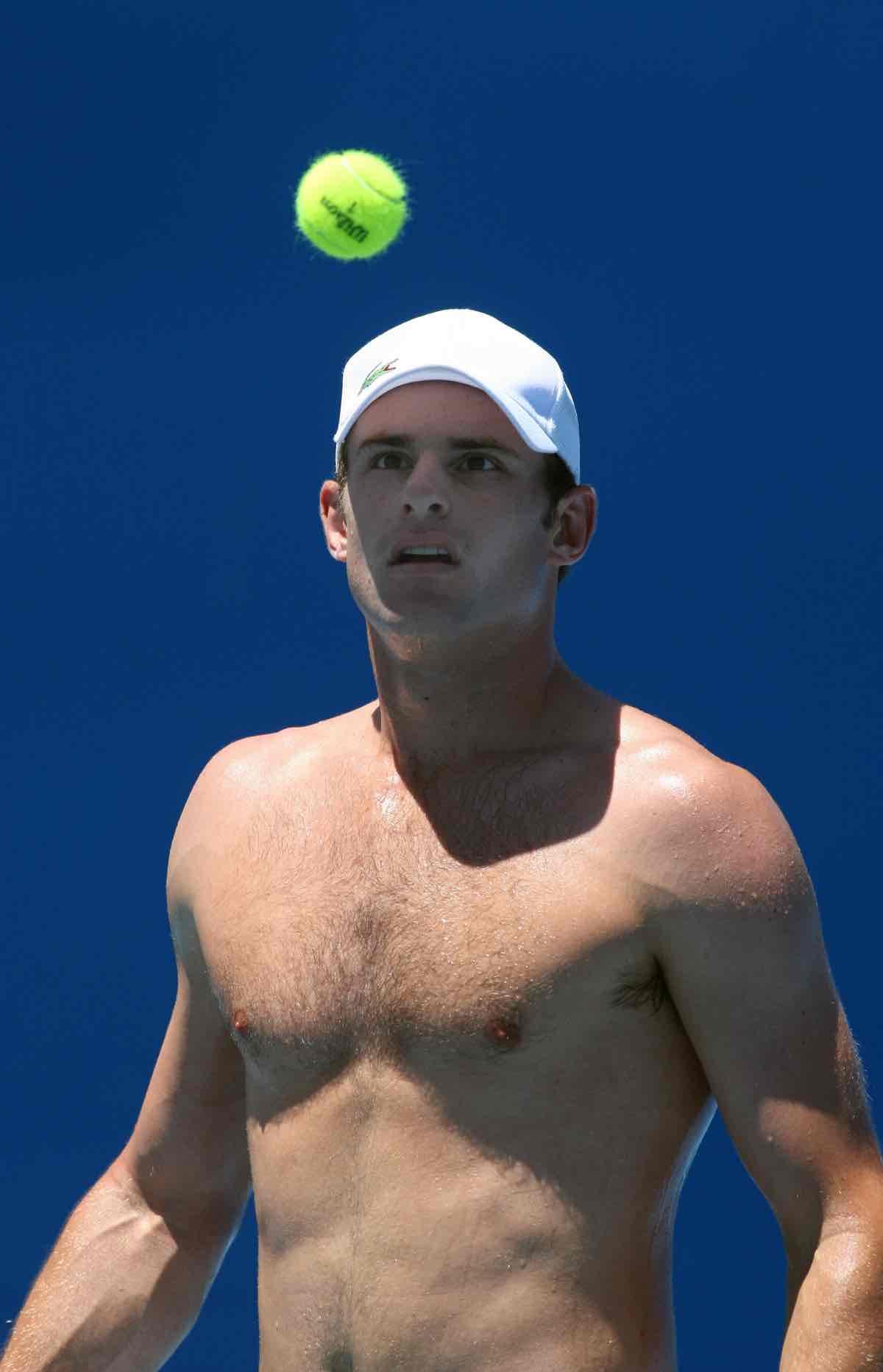 Andy Roddick of the US smashes the felt