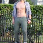 Garrett Clayton shows off his six pack abs while skateboarding in Los Angeles