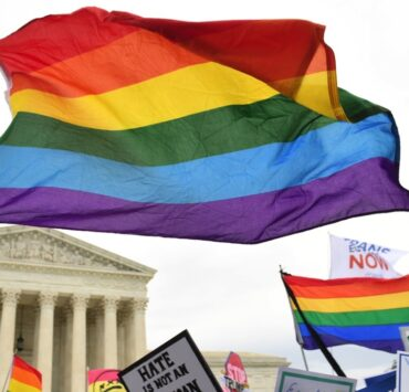 Demonstrators in favor of LGBT rights rally outside the US Supreme Court
