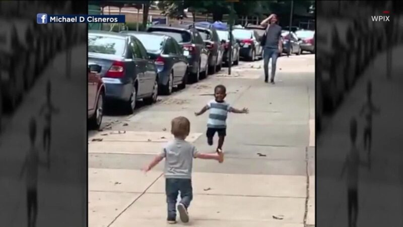 Toddlers going in for a hug