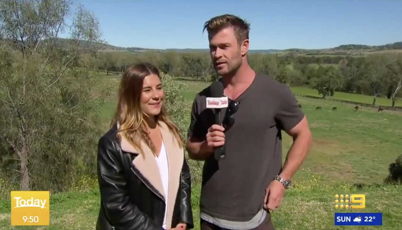 Chris Hemsworth Hilariously Crashes a Weather Report class=